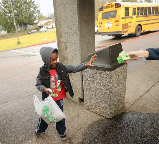 Kitsap Sun / School meal deliveries a lifeline to normalcy in 'crazy' times
