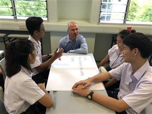 Mr. Davis teaching in Singapore