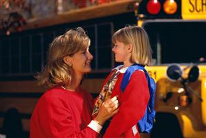 Mother seeing child off on school bus